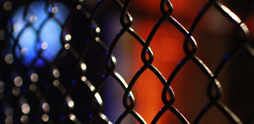 Chain link fencing around MMA arena