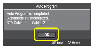 OK button on TV prompt confirming auto programming has completed