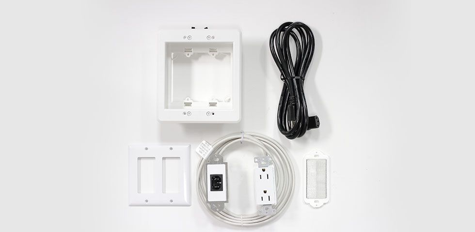 Power relocation kit including a recessed outlet box and in-wall cabling