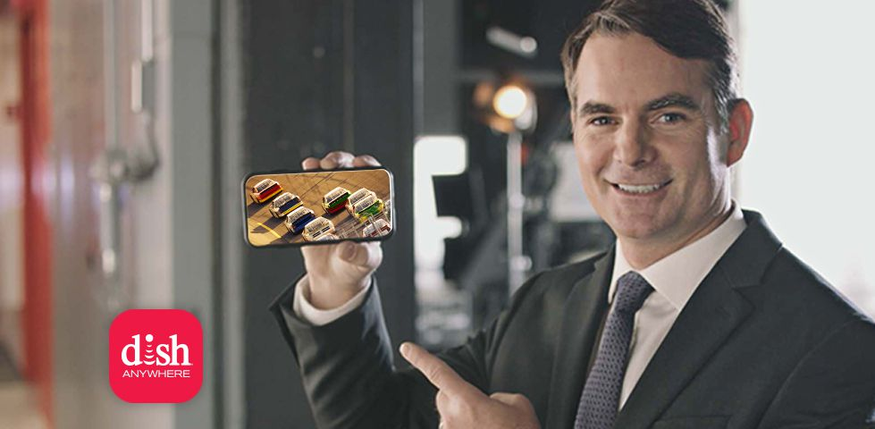 Jeff Gordon holding a phone showing a NASCAR race