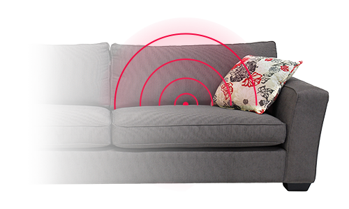Couch with red circles coming from behind cushion