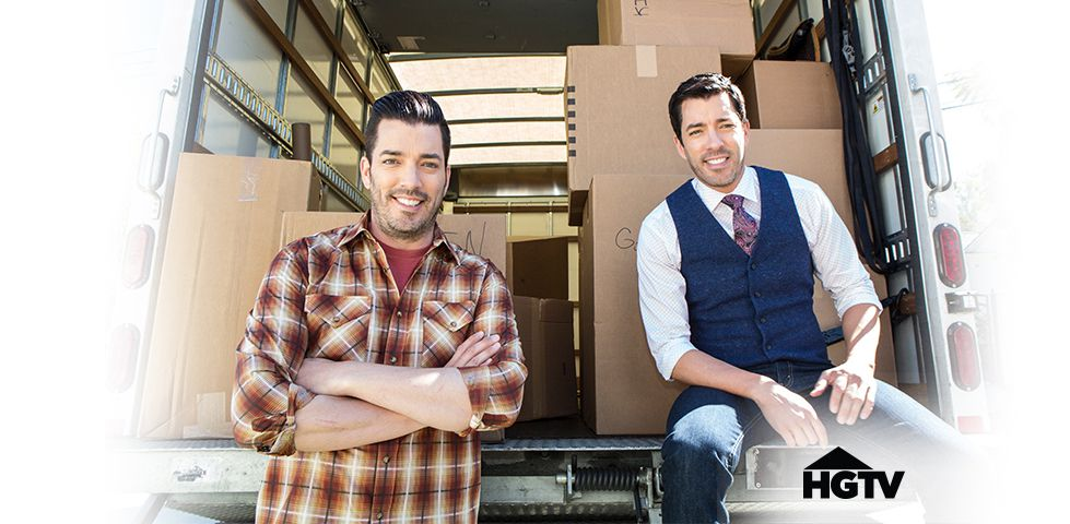 the Property Brothers at the back of a moving truck