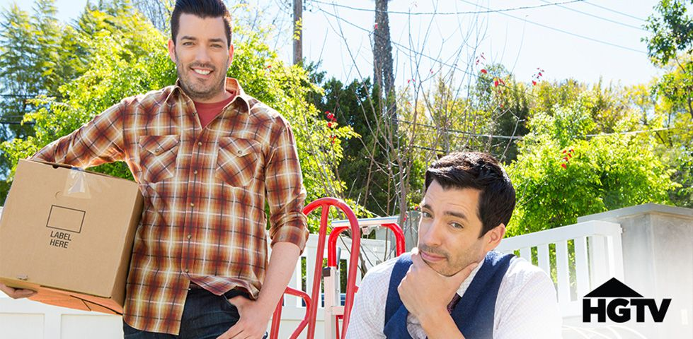 Property Brothers holding moving boxes