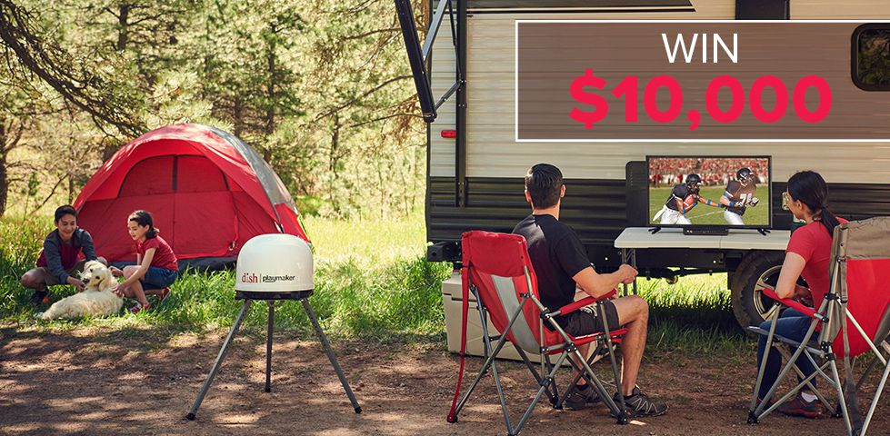 Family watching TV by their RV with a DISH portable antenna