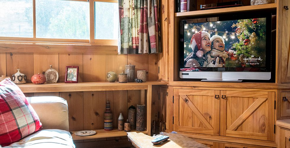 Hallmark programming on a TV in a rustic living room