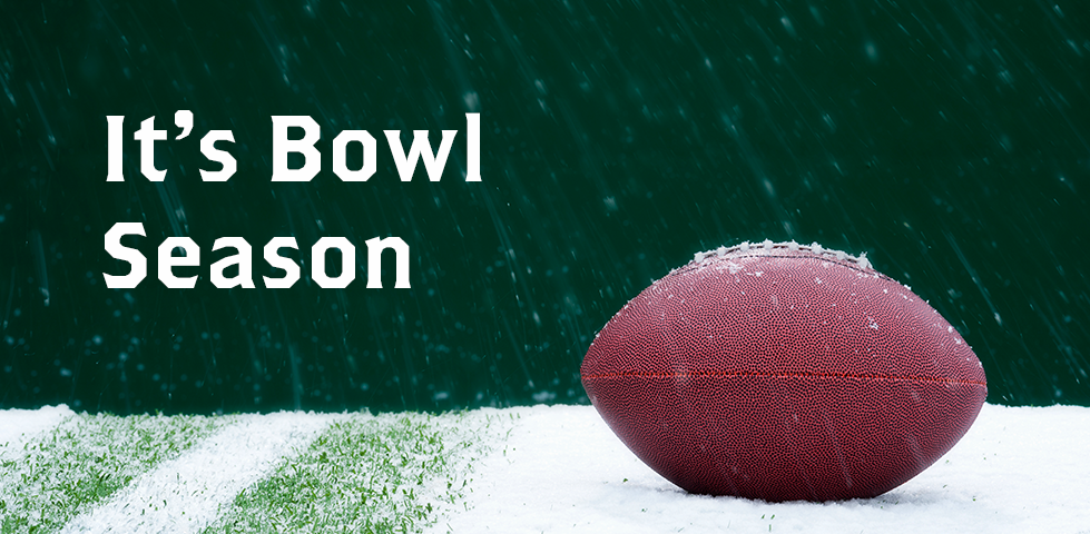 It's Bowl Season | football laying on a snowy field