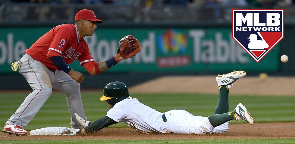 Los Angeles Angels player with his baseball glove out as Oakland Athletics player slides to the base