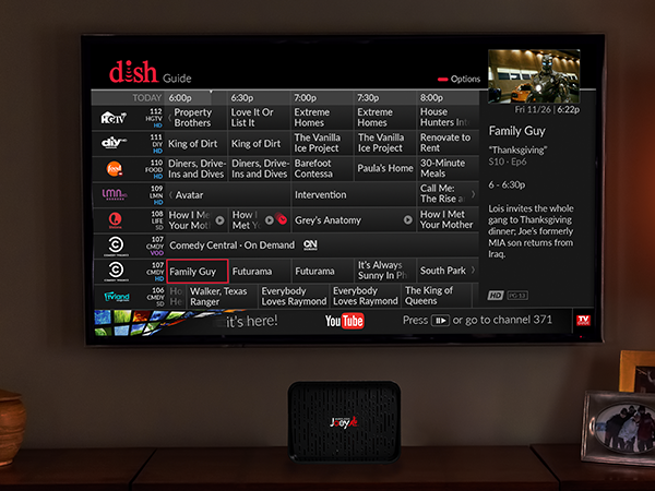 DISH Wireless Joey receiver on an entertainment center under a wall-mounted television